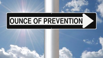 Ounce of Prevention sign against a blue sky
