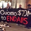 "Activists occupy the ""War Room"" of the N.Y. Capitol to ensure the state budget includes $70 million to end AIDS."