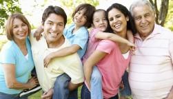 A multi-generational latin family having fun outdoors
