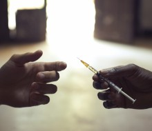 drug users passing a syringe