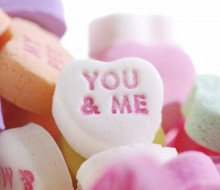Valentine's candy hearts with the words YOU & ME