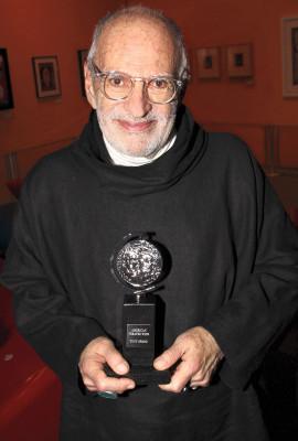 Larry Kramer Kramer holds  the 2011 Tony Award for Best Revival of a Play for The Normal Heart.